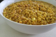 Dhal is the perfect colorful, nourishing and filling Indian dish! With all the warming combination of spices and your choice of brown rice, quinoa or millet, this meal is also very healthy and high in protein andhigh in carbohydrates whilst being virtually fat free. Put a little olive oil in a stainless steel pan; add the mustard seeds, cumin seeds, the finely diced onion and stir for 1 minute. Add the grated ginger, fresh lemongrass, fresh mint leaves, coriander powder, turmeric powder,