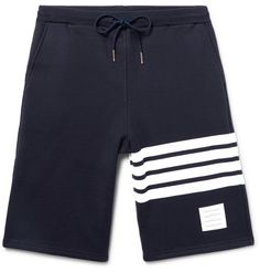 Thom Browne's sporty shorts are made from loopback cotton-jersey and finished with the brand's signature four stripes. They are fitted with a drawstring waistband and designed with a straight-leg cut that hits at the knee. Wear yours with box-fresh sneakers.