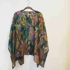 Open Mardi Gras-style snakeskin chiffon cape Mardi Gras appropriate! Sheer long open New Orleans-style, snakeskin chiffon cape with silver sequins around collar. In excellent condition! Accesory Street Tops Tunics