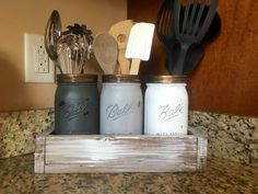 Complete your kitchen with this gorgeous utensil caddy. This package includes everything shown in the picture.  Adding a stencil is a small additional fee  This jars are by far my favorite color combination that we offer. Package includes:  (1) planter box white washed (3) mason jars (2) installed handles If youd like different color jars, planter box, or handles please let me know! I love making custom orders