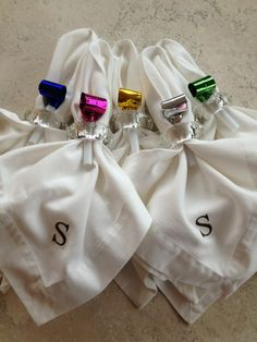 Add the noisemakers to each place setting by way of the napkin rings! Not only will it add color to a white napkin, but it also provides each guest with a fun way to ring in the New Year!