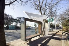 placed at an intersection of nature and city on a mountain in seoul, this bus shelter is formed from three elements which frame the environment and activity occurring in and around the structure. Landscape And Urbanism, Landscape Structure, Urban Furniture, Street Furniture, Urban Architecture, Architecture Details, Bus Stop Design, Urban Ideas, Bus Shelters