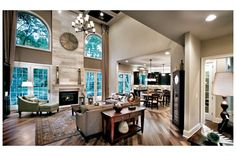 Floor-to-ceiling windows flank this light-filled great room on one side, creating a warm and inviting space. The Princeton model by Toll Brothers at the Dominion Valley Country Club - Carolinas new home community, near Washington, D.C.