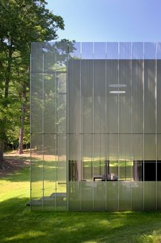 transparent up close. solid afar. corrugated screens of perforated, stainless steel. Salt Point House by Thomas Phifer and Partners