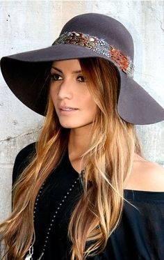 wide brim floppy hat, straight tousled hair