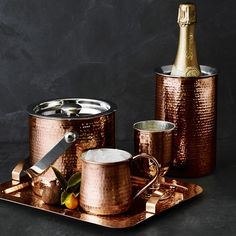 Bring the warmth of copper to your tabletop with our elegant wine chiller. Crafted of copper-plated stainless steel, artisans hand hammer the exterior and polish it to a brilliant finish. Sized to hold a standard bottle, this chiller covers the bo… Hammered Copper Mugs, Copper Pots, Copper Tray, Copper Kitchen Accessories, Bar Accessories, Copper Decor, Wine Chiller, Bronze Patina, Bar Set