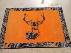 I'm not completely in love with this but I know Jay will say it's a must.. Hunter's orange and camo oversized deer rug