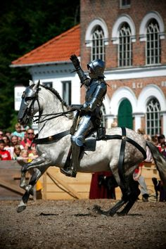 (photo by Isis Sturtewagen) Arne Koets sits in his historic war saddle on his Andalusian gelding Maximilian at the Nyborg jousting tournament 2013.