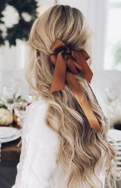 blonde balayage hair | half ponytail bow hair tie | long curls | long hair ideas