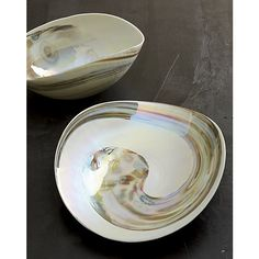 Shop Fossili Centerpiece Bowl.  Warm browns and iridescent ivory swirl on the seashell curves of this stunning example of Murano glass.