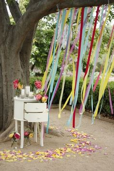 """Some bunting and streamers hanging on earthier side of garage open garage door and shed would add a fun, festive feel, and, hopefully, help diminish the """"garage"""" feel."""