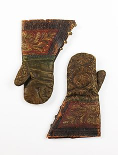 Mittens  Date:     late 17th century Culture:     Russian Medium:     leather, silk, metal Dimensions:     13 1/4 in. (33.7 cm) Accession Number:     2009.300.2680a, b