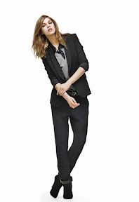 Menswear-inspired blazer featuring a single-button closure and hip  flap pockets.