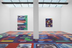 Impressive floor painting installation welcomes visitors into the intriguing Dark Matter of artist Sarah Cain...