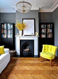Gray and yellow trend re-birth done right! That herringbone floor doesn't hurt things a bit! | Bookroom in Plummett by Farrow and Ball. Fab yellow chair from Oliver Bonas.