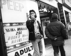 The Times Square Leland Bobbe encountered in the 70s would not have attracted the hordes of tourists the area does today. Here, a man is photographed smoking outside a peep show shop.