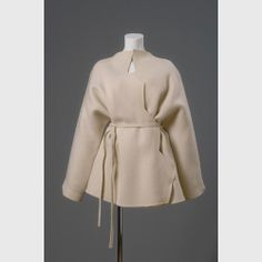 American designer Geoffrey Beene designed this wool coat with silver metal topstitching  in the late 1990's.  Source: Phoenix Art Museum
