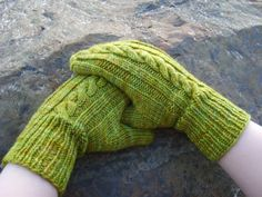 I've been wanting to find a good cabled mitten pattern to make - I like these and LOVE the color!