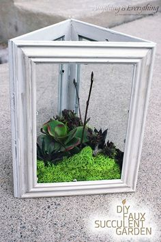 Or, glue three picture frames together to make a simple faux (or real!) terrarium.