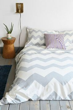 Zigzag Duvet Cover - comes in a really neat yellow/gold color that would look awesome with a yellow/grey theme. Also comes in lighter blues