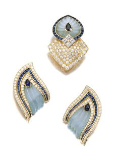 Gem set and diamond demi-parure, Boucheron, 1980s ,$6,875.00  Comprising: a pair of ear clips and a dress clip set with carved rock crystal, cabochon and calibré-cut sapphires and brilliant-, and carré-cut diamonds, all signed Boucheron, stamped with French assay marks, dress clip numbered, additional fitting to enable ear clips to be worn together as a brooch; accompanied by associated case signed Boucheron, Paris.