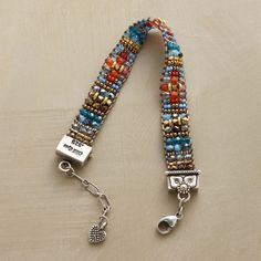 """PRAIRIE BELLE BRACELET-$495.00 -Hand loomed by Adonnah Langer, this dainty, beaded bracelet recalls prairie flowers and blue skies with Japanese brass and fire-polished Czech crystal beads. Sterling end caps and clasp. USA. Exclusive. 6-1/2"""" to 7-1/4""""L."""