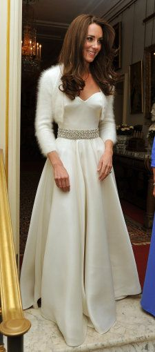 Kate Middleton slipped into another dress designed by McQueen creative director Sarah Burton: a white satin strapless evening gown with a circle skirt and diamante detailing around the waist. She topped the look with a simple white shrug.