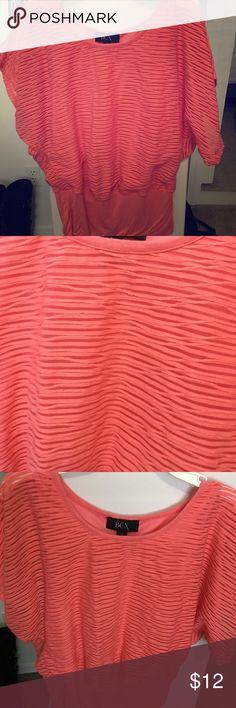Orange dressy top Orange dressy top. Has flared arms. Looks really cute. BCX Tops Blouses