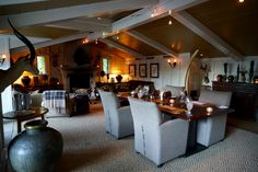 Dining in the Trophy Room at the Huka Lodge, New Zealand.