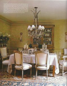 (BrandonRugs.com) A beautiful antique Persian Serapi-Heriz rug is the elegant foundation for this relatively understated dining-room