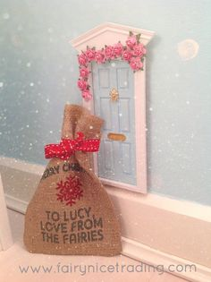 A magical Christmas delivery from the Fairies to this pretty blue Fairy Door