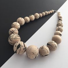 Street inspired spray painted statement necklace, handmade using untreated birch wooden beads. A simple and unique design that would make a lovely addition to any look.  With an Ingterior product you get a one off that is unique and individual. A handcrafted piece that is personal to you. Total length: 500mm    https://www.etsy.com/uk/shop/ingterior