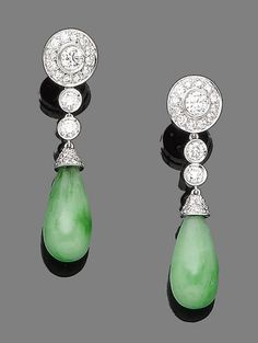 A pair of jade and diamond pendent earrings  Each jade drop, capped by pavé-set brilliant-cut diamonds, surmounted by a trio of similarly-cut diamonds in collet-settings, the largest to the top within a similarly-cut diamond surround, diamonds approx. 1.85cts total, jade untested, length 4.2cm