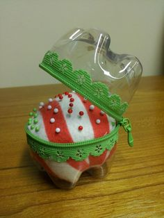 Pin cushion made from the bottom of two soft drink bottles