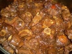 Savory oxtail in a rich and thick gravy. Hearty oxtail in a rich and thick sauce. Jamaican Cuisine, Jamaican Dishes, Jamaican Recipes, Beef Recipes, Cooking Recipes, Jamaican Oxtail, Oxtail Recipes Crockpot, Jamaican Chicken, Gourmet