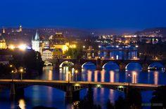 Numerous bridges including the Charles Bridge span the river Vltava in Prague, Czech Republic.