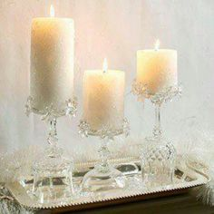 Crystal candle holder's ...crystal wine glasses turned upside down for height.