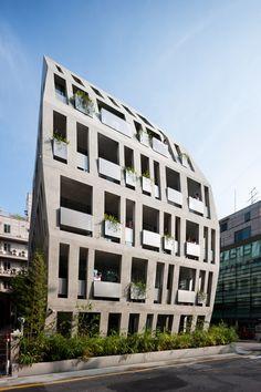 Swollen concrete facades increase floor area inside Archium's Gilmosery office block.