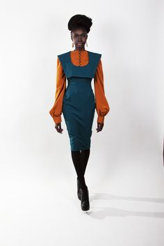 SIGNATURE FIT SHEATH DRESS (STRETCH) Order 1 size smaller than your size  Color: Teal  Style Features      * Bib Collar     * Signature Wanda Grace Fit  Can be worn as a jumper or a dress  For sizing, see Fit Guide  Dry Clean Only