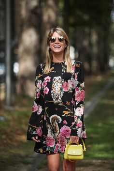 How To Dress Like An Italian Girl — 50+ Lessons Worth Knowing #refinery29 http://www.refinery29.com/2014/09/74945/milan-fashion-week-2014-street-style#slide84 A precious mini bag and oversized blossoms are a hoot.