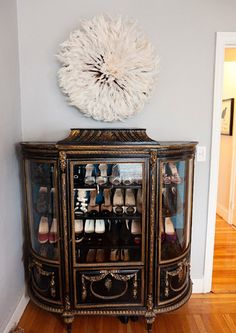 Shoe Storage | House & Home. { Amazing! Such a beautiful cabinet! Gorgeous shoe storage and display. Need to find one like this! }