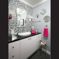 Hot Pink Accessories Are Contrasted By A Highly Polished Black Quartz Vanity Top And Soft Gray