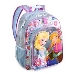 Disney Frozen Backpack - Personalizable | Disney StoreFrozen Backpack - Personalizable - She'll lead a cold trend with this fashionable Frozen Backpack. Anna and Elsa are pictured on a clear panel against a dazzling ice blue background layer. Personalize it so she can really make a name for herself wherever she goes.