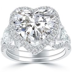 Image shared by Liori Diamonds. Find images and videos about heart, rings and diamond on We Heart It - the app to get lost in what you love. Engagement Sets, Best Engagement Rings, Vintage Engagement Rings, Best Diamond, Diamond Rings, Diamond Dreams, Diamond Jewelry, Halo, Diamond Stores