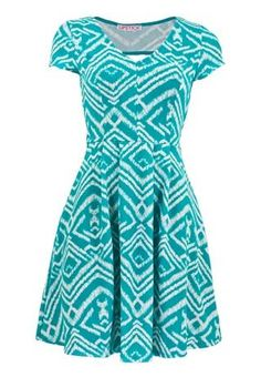TEXTURED SKATER OPEN BACK DRESS  Eh….maybe in a different color, but it's cute….