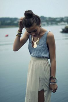 bun, bracelets, statement necklace, maxi skirt