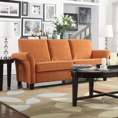 The Portfolio Rockford SoFast sofa features rolled welted flared arms and can be assembled in less than 2 minutes. The ultra comfortable Rockford sofa is covered in a luxurious soft pumpkin orange velvet.