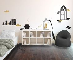 """Make your walls enchanting with <a href=""""https://go.redirectingat.com?id=74679X1524629&sref=https%3A%2F%2Fwww.buzzfeed.com%2Fmaitlandquitmeyer%2Fhogwarts-decor&url=https%3A%2F%2Fwww.etsy.com%2Flisting%2F197985163%2Fharry-potter-inspired-wizards-room&xcust=4329193%7CBFLITE&xs=1"""" target=""""_blank"""">a decal set</a> that includes a Hogwarts window, broom, and bookshelf."""
