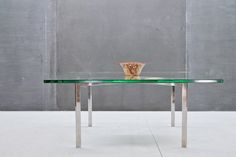 Vintage Knoll Barcelona Glass Table 20th Century Vintage Industrial USA, c.1970s. Vintage Ludwig Mies Van de Rohe Barcelona Glass and Polished Steel Coffee Table. Some Scratches to Glass Surface, but Overall Good Condition and No Edge Wear to 3/4 Inch Thick Clear Polished Beveled Plate Glass. Marked with KP to Underside of Steel Frame with Mirror Finish.  W: 40 x D: 40 x H: 17 in.
