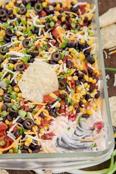 Southwestern 7 Layer Dip - Layers of kicked up tomatoes, black beans and corn on. - Southwestern 7 Layer Dip - Layers of kicked up tomatoes, black beans and corn on. Southwestern 7 Layer Dip - Layers of kicked up tomatoes, black bea. Appetizer Dips, Yummy Appetizers, Appetizers For Party, Mexican Food Appetizers, Food For Parties, Snacks For Party, Superbowl Party Food Ideas, Health Appetizers, Pool Snacks